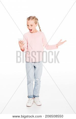 Young child looking at smartphone screen and looking dissatisfied isolated on white
