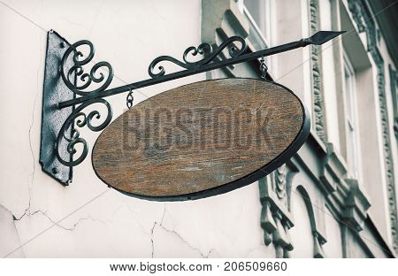 Empty wooden outdoor signage mockup to add company logo.