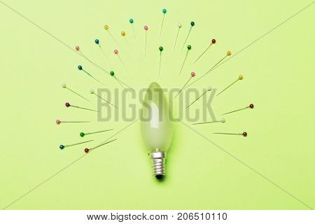 Light Bulb In Oval Form As Center Of Composition