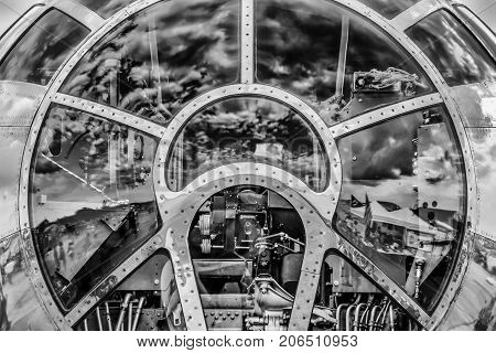 The sky reflecting off the front of a cockpit.