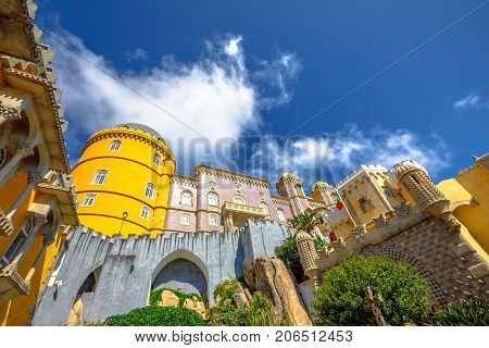 Prospective view of different architectural styles of colorful National Palace of Pena, one of the seven wonders of Portugal and Unesco Heritage.Pena Castle is a popular landmark in Sintra near Lisbon