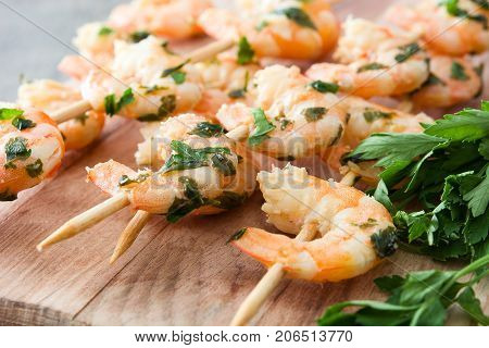 Healthy shrimp skewers on wooden table background