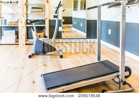 Home Gym With Treadmill, Mirror And Bicycle Machine With Sunlight Coming Through Window In Home, Apa