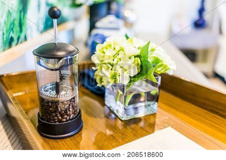 Closeup Of Breakfast Wooden Tray With Coffee French Press And Flowers Decoration In Home, House Or A