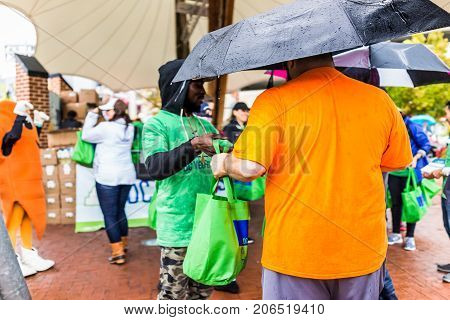 Washington Dc, Usa - September 2, 2017: People Waiting In Line Queue Holding Umbrellas During Heavy