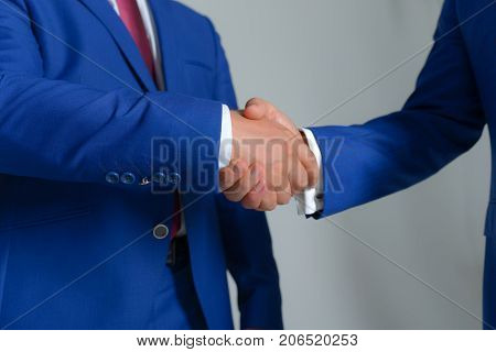 Businessmen Hands In Formal Suits Greet Each Other. Company Leaders