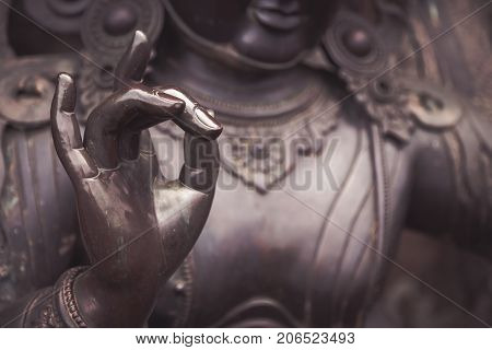 Detail Of Buddha Statue With Karana Mudra Hand Position