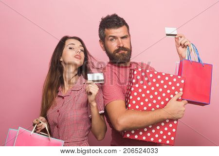 Guy With Beard And Lady Do Shopping. Money Spending
