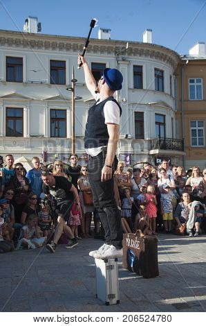 LUBLIN, POLAND- 29 july 2017- fire swallower with flaming torch at Carnaval Sztukmistrzow Festival placed in city space of Lublin and dedicated to theatre, circus and street art