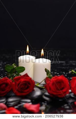 Beautiful red rose with two candle and therapy stones