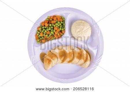 Sliced chicken tv dinner isolated on white background.