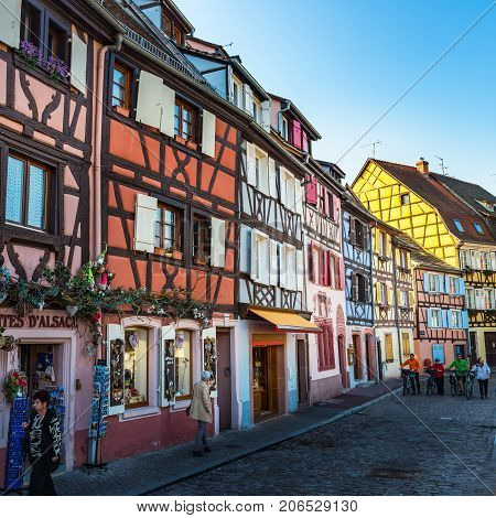 Colorful Traditional French Houses And Shops In Colmar, Alsace,