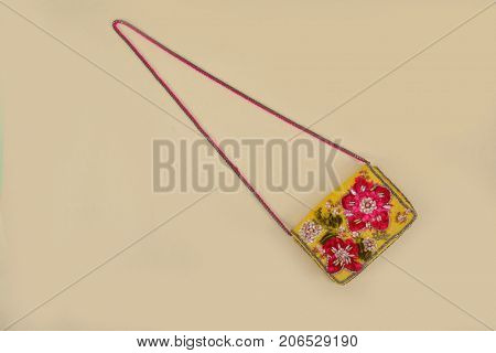 Handbag background- Embroidered hand made flowers with flowers.- beige background