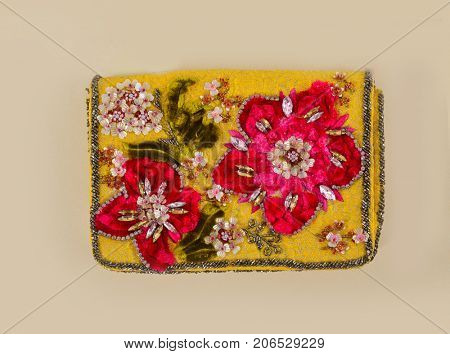 Handbag background- Embroidered hand made flowers with flowers-. beige background