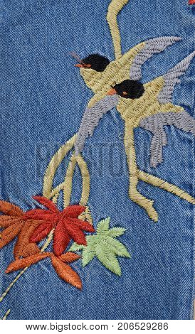 Embroidered bird flowers , legs jeans texture