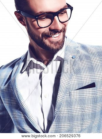 portrait of handsome fashion stylish hipster businessman model dressed in elegant light blue suit in glasses isolated on white