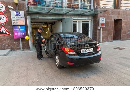 Moscow, Russia - September 23. 2017. Inspects the car at the entrance to the underground garage on Rozhdestvenka Street