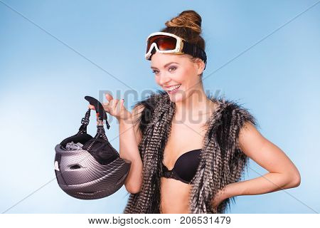 Woman Wearing Bra And Holding Ski Helmet
