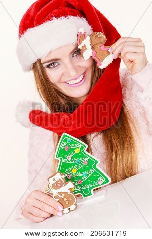 Woman Santa Claus Hat With Gingerbread Cookies. Christmas