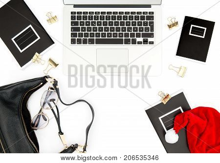 Office desk with Christmas decoration on white background. Fashion flat lay for social media