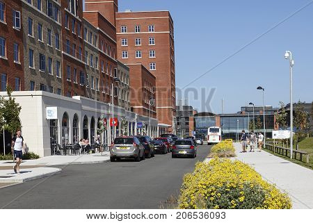 Swansea, UK: May 5, 2016: The Swansea Bay Campus is the home to the College of Engineering and School of Management. Students walk down the Main Street in Swansea Bay Campus.