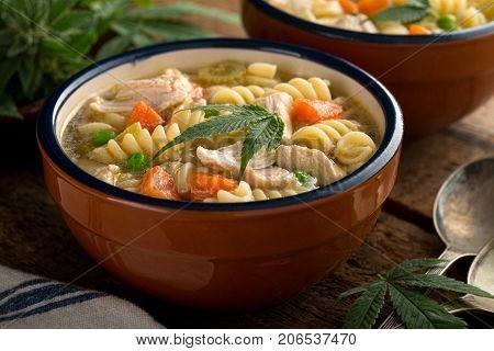 A bowl of delicious hearty homemade marijuana chicken noodle soup.