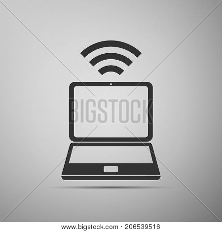 Laptop and wireless icon. Wireless technology, wifi connection, wireless network, hotspot concepts icon isolated on grey background. Flat design. Vector Illustration