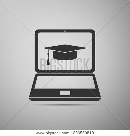 Graduation cap and laptop icon. Online learning or e-learning concept icon isolated on grey background. Flat design. Vector Illustration