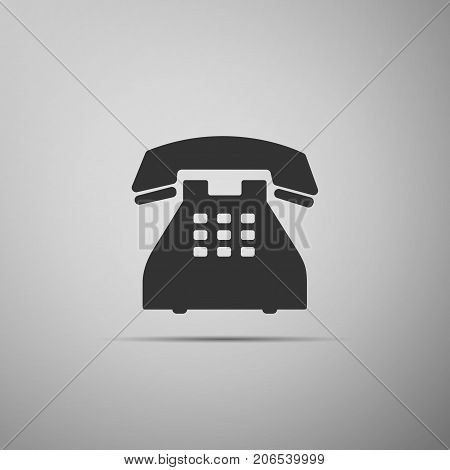 Telephone icon isolated on grey background. Landline phone. Flat design. Vector Illustration