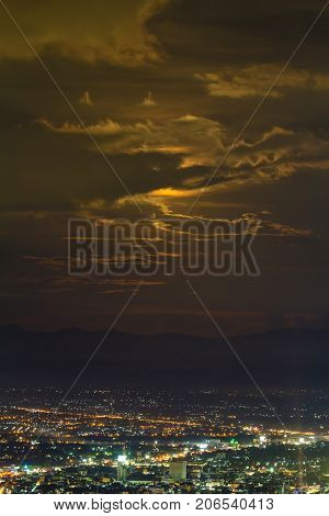 View Of City At Night With Cloud And Moonlight From The View Point