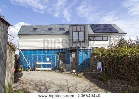 Cornwall, UK: April 14, 2016: A self build detached house during development. An eco-friendly design with solar panels. Self build is possibly the most inexpensive way to attain a large detached home.