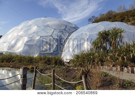 St Austell, UK: April 13, 2016: View of the biomes at the Eden Project. Inside the biomes, plants from many diverse climates and environments have been collected and are displayed to visitors.