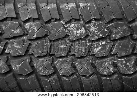Background of the tire tread . Photo of an abstract texture