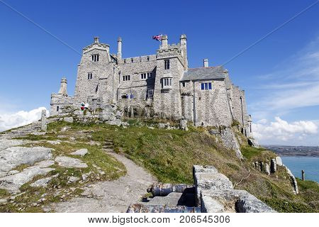 Cornwall, UK: April 12, 2016: Tourists are viewing the castle on St Michael's Mount. It can only be accessed during low tide by walking over the causeway.