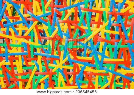 Close up abstract image or texture of colorful plastic weave.