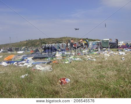 Carmarthen, UK: July 31, 2011: Beach Break at Pembrey Country Park has been a popular music event for the young people of wales. Campers are seen leaving the area in a mess with litter and discarded items