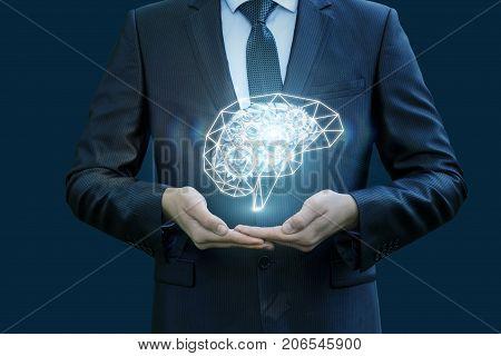 Businessman Hand Shows Brains.