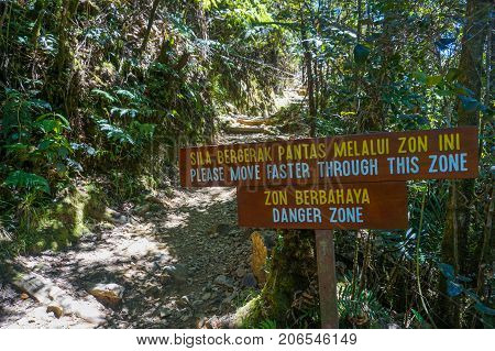 Ranau Sabah Borneo-March 12,2016:National park sign:Danger Zone at Timpohon trail to Laban Rata of Mountain Kinabalu,Sabah.Climbing season officially start on Dec 1,2015 after closure due to earthquake on June 2015.