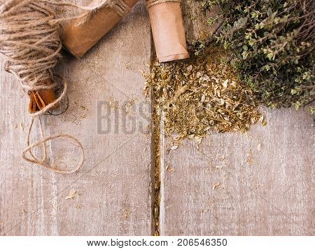 Natural health herb background with free space. Herbal infusion closeup, messy workplace, herbage concept