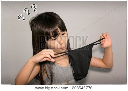 Child's Curious Reaction to Woman's Black Underwear