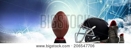 Digital composite of American football helmet ball and gear with technology transition