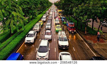 BANGKOK THAILAND - SEPTEMBER 10: Traffic backs up on Petchkasem road on a wet Sunday on September 10 2017 in Bangkok.