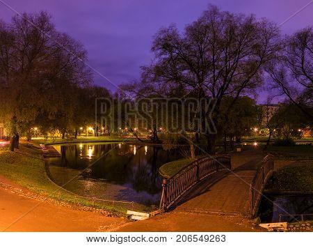 Night view of park pond and bridge in Yusupov Garden Saint Petersburg Russia