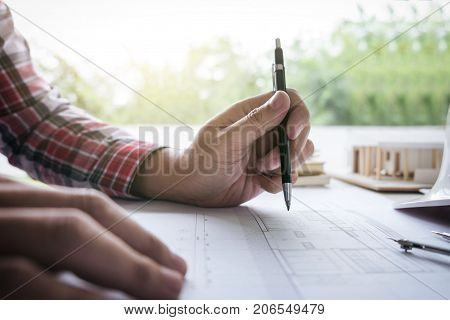 Architecture Engineer Drawing and working for architectural project and engineering tools on workplace concept of work on technical drawings and construction.