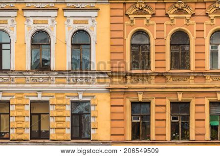 Several windows in a row on facades of two different apartment buildings adjacent tightly to each other front view Saint Petersburg Russia