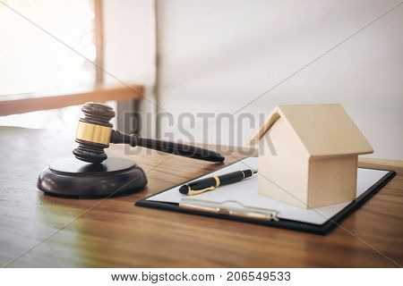 Gavel on sounding block at courtroom for decide home insurance Law and justice concept Settle a house dealing lawsuit.