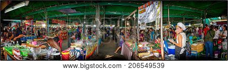 BANGKOK THAILAND - JULY 31: Local vendors do business in a local traditional outdoor market in the afternoon on July 31 2017 in Bangkok.