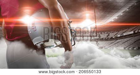 Digital image of goal post at American football stadium with smoke