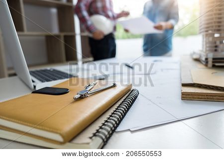 Architecture Engineer Teamwork Meeting Drawing and working for architectural project and engineering tools on workplace concept of work on technical drawings.