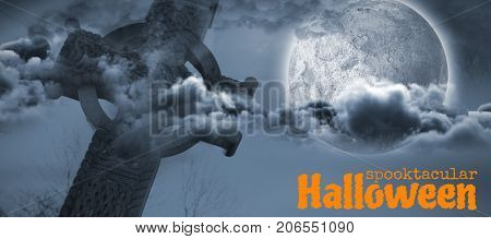 Graphic image of spooktacular Halloween text against celtic cross in front of moon behind clouds